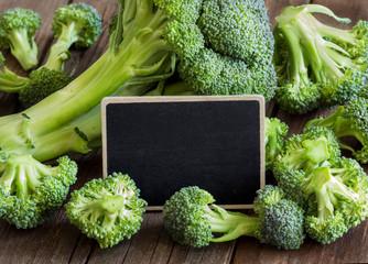 Fresh broccoli with small chalkboard