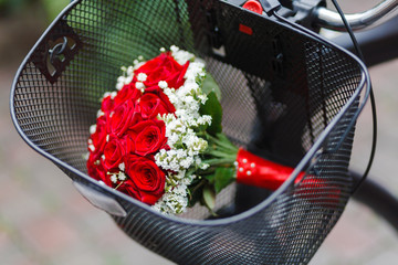 Wedding bouquet in the basket of bicycle