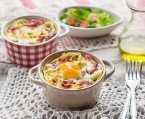 Baked pasta spaghetti carbonara with egg yolk, cheese and bacon
