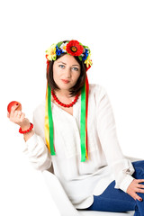 beautiful young brunette woman wearing national ukrainian clothe