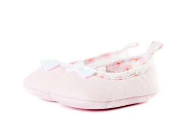 Close up pink baby shoes side view