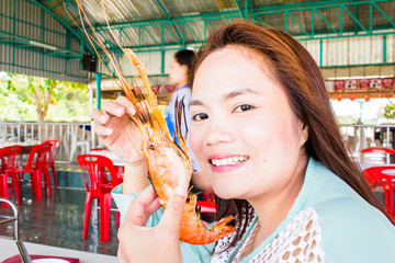 teenage girl with grilled prawns, samui thailand