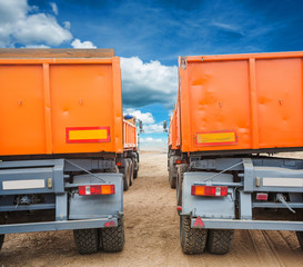 rear view through rows of tippers