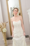 Beautiful young happy bride in a  white and ivory wedding dress