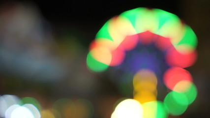 Out of focus lighting on ferris wheel