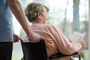 Disabled woman in retirement home