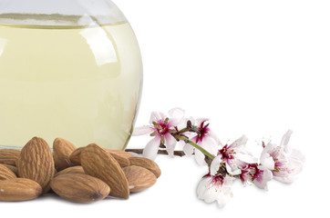 almond oil and almonds with flowers