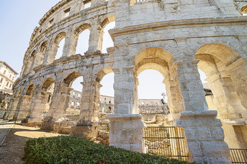 A fragment of wall of antique Roman amphitheater in Pula