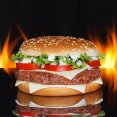 Hamburger on black background with refletion and real fire