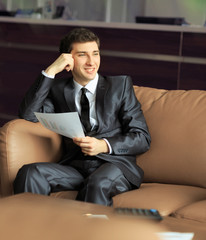 Relaxed businessman sitting at Desk