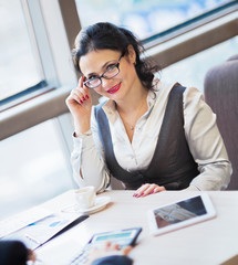 Young businesswoman sitting at workplace
