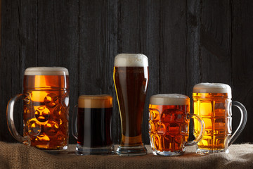 Beer glasses with lager, dark lager, brown ale, malt and stout