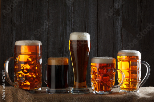 Fotobehang Bier Beer glasses with lager, dark lager, brown ale, malt and stout
