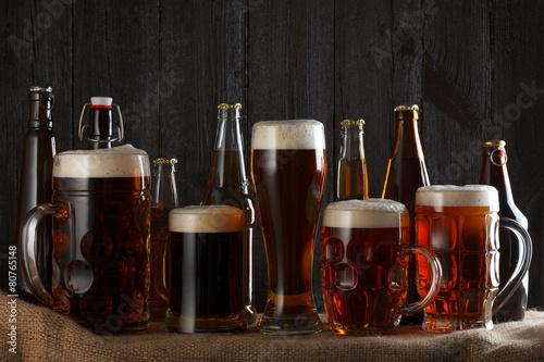 Beer lager, dark lager, brown ale, malt and stout beer on table Poster
