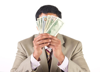 Corporate executive covering face with  currency