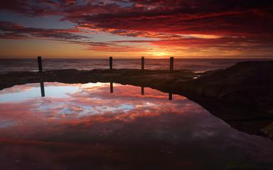 Spectacular sunrise over Ivo Rowe Rockpool Coogee Australia