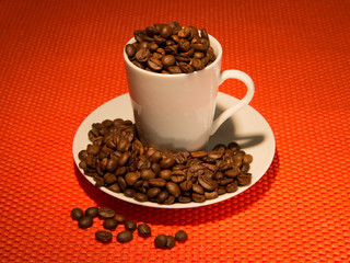Сoffee beans on a red background