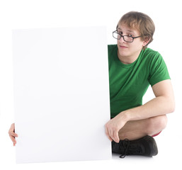 Man Sitting on the Floor with White Empty Board