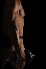 Sport and Fitness. Sexy bodybuilder holding dumbbell isolated on