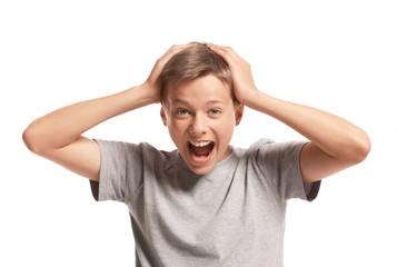 Amazed teenager holding his head