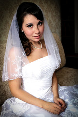 Modest bride woman with wedding makeup and hairstyle