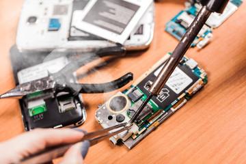 worker repairing fractured phone