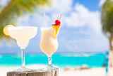 two perfect cocktails pina colada and margarita with cherry on
