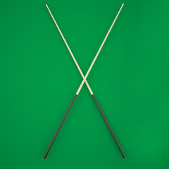 Crossed cue on a green billiard table