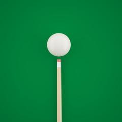 Billiard balls before hitting on a green billiard table