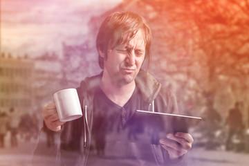 Man Reading Bad News on Digital Tablet Computer