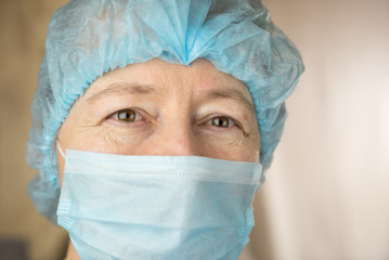 Smiling female doctor in hospital hallway