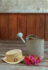 Vintage tone style hat and flower on the wood floor
