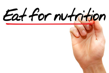 Hand writing Eat for nutrition with marker, health concept