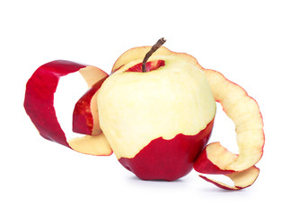ripe red apple with peeled skin on a white background