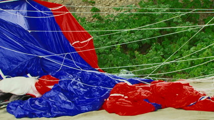 Cloth Of Blue And Red Parachute Swaying On Breeze
