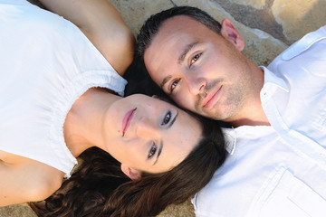 Young couple lying on a stone floor