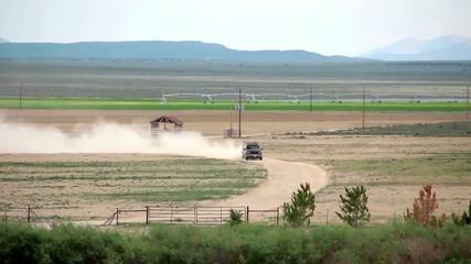 Truck is Crossing a Field