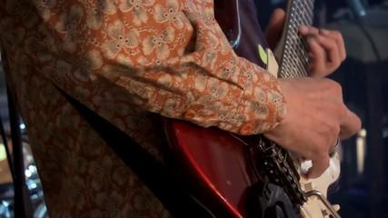 Playing rhythm guitar at the disco.