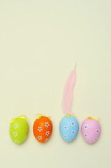 decorated easter eggs and feather
