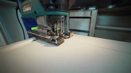 A machine cutting the peace of veneer.  Close up