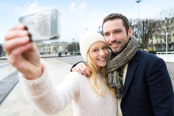 Young couple on holidays taking selfie