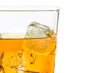 whiskey in glass with ice on white background