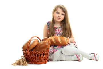 little girl with a loaf of bread in his hand