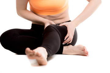 Close up of female legs, girl massaging sore thigh