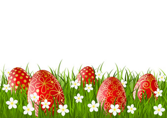 Red Easter eggs on green grass