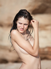 Young naked woman smiling