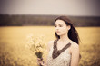 brunette girl with yellow bouquet