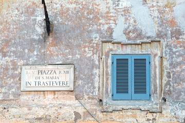 Piazza di Santa Maria sign on old house in Trastevere, Rome
