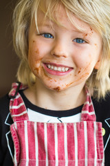 Happy, smiling child with messy chocolate face