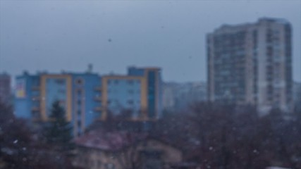 With the focus on the snow, a dark day is shown in the city